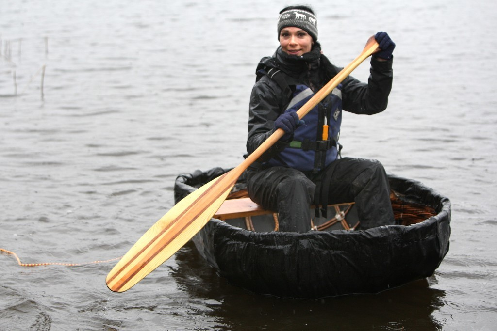 Gayle paddles her coracle.