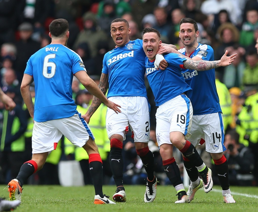 Barrie McKay is mobbed by team-mates after scoring Rangers' second goal.