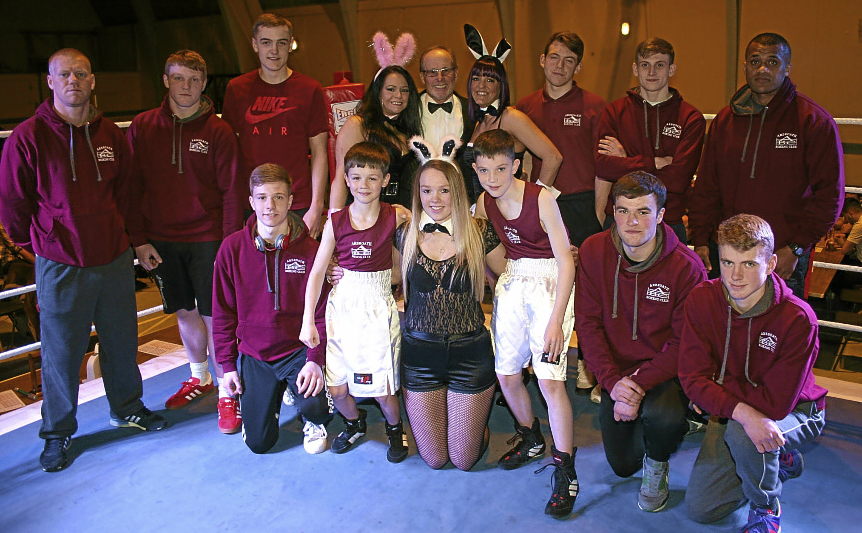 The Arbroath boxers who took part with ring girl Louise Berrie at the front.