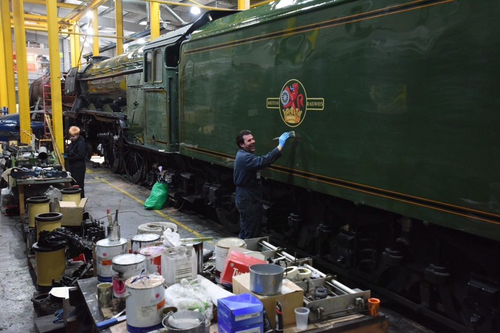 Dated: 17/02/2016 FLYING COLOURS ... The finishing touches are made to the successful completion of a £4.2m ten-year restoration project upon the iconic Flying Scotsman steam locomotive, which saw the numbers 60103 applied to the cab and marked the final stages of its transformation from business-like black to BR green, ready for its inaugural run. See story North News #NorthNewsAndPictures/2daymedia