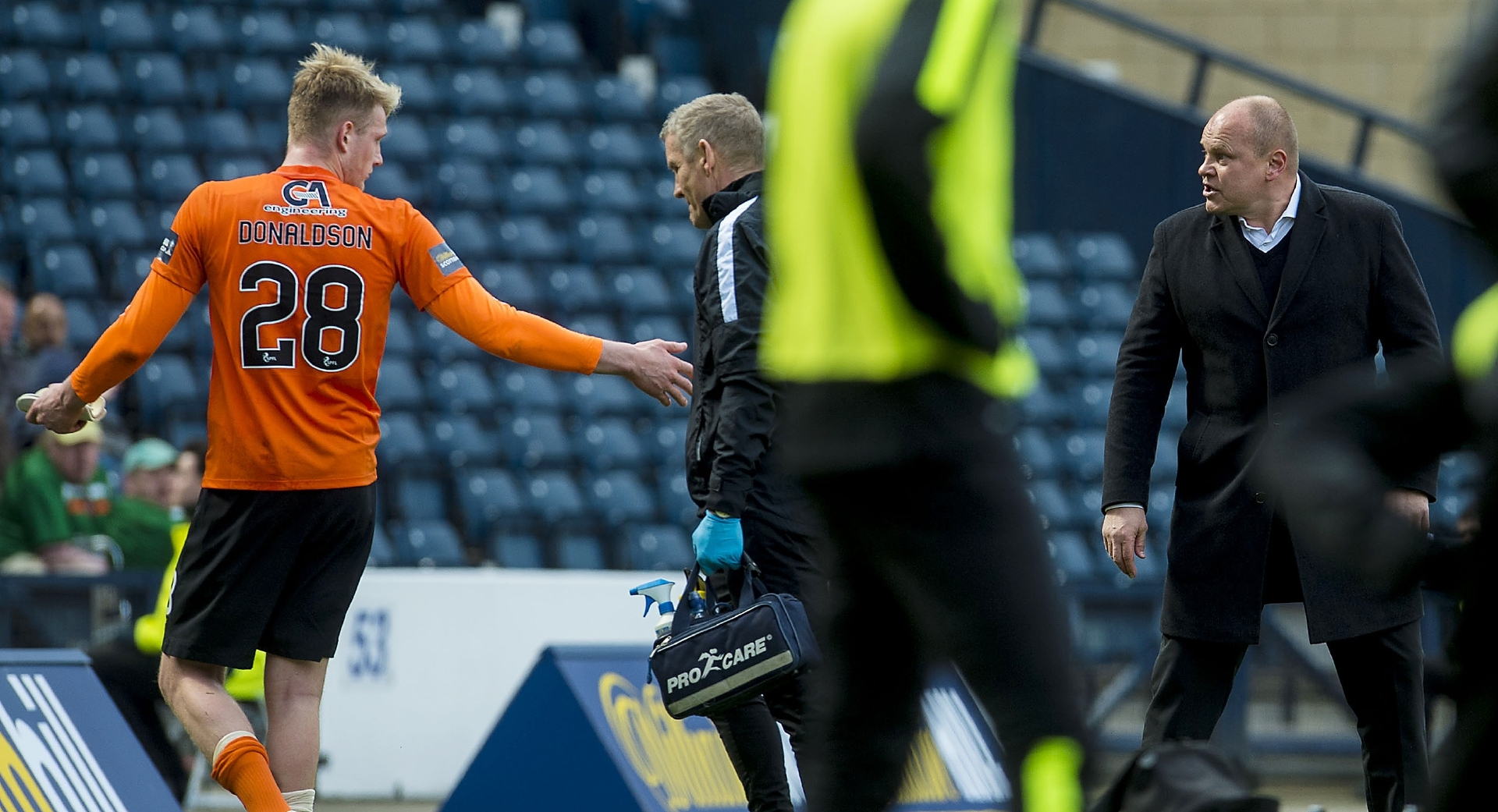 Mixu Paatelainen (right) has words with the injured Coll Donaldson during the semi-final.