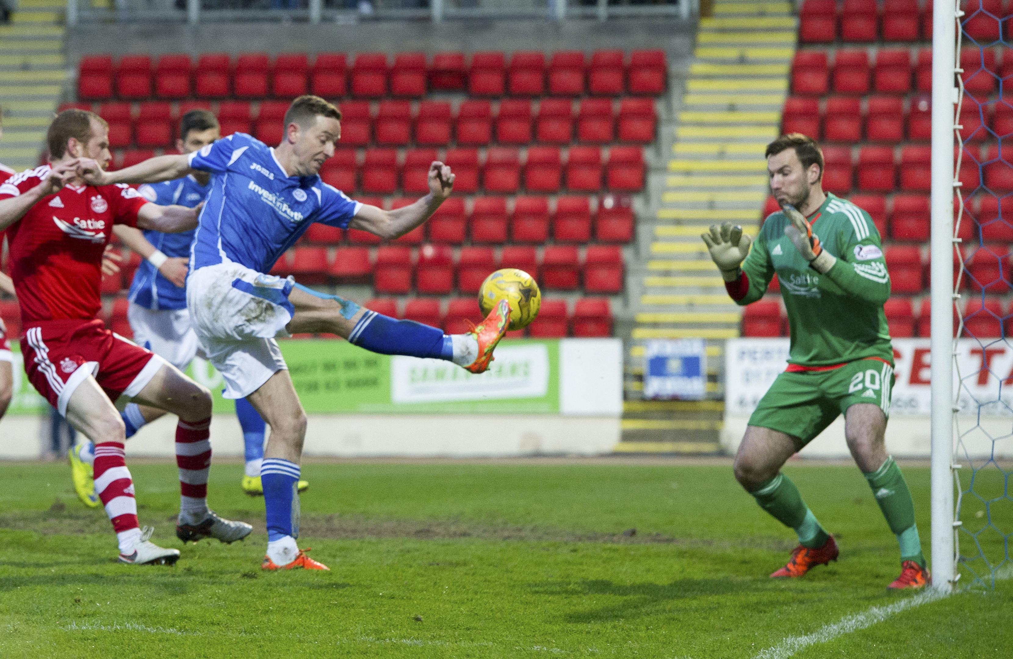 Steven MacLean scores against Aberdeen.