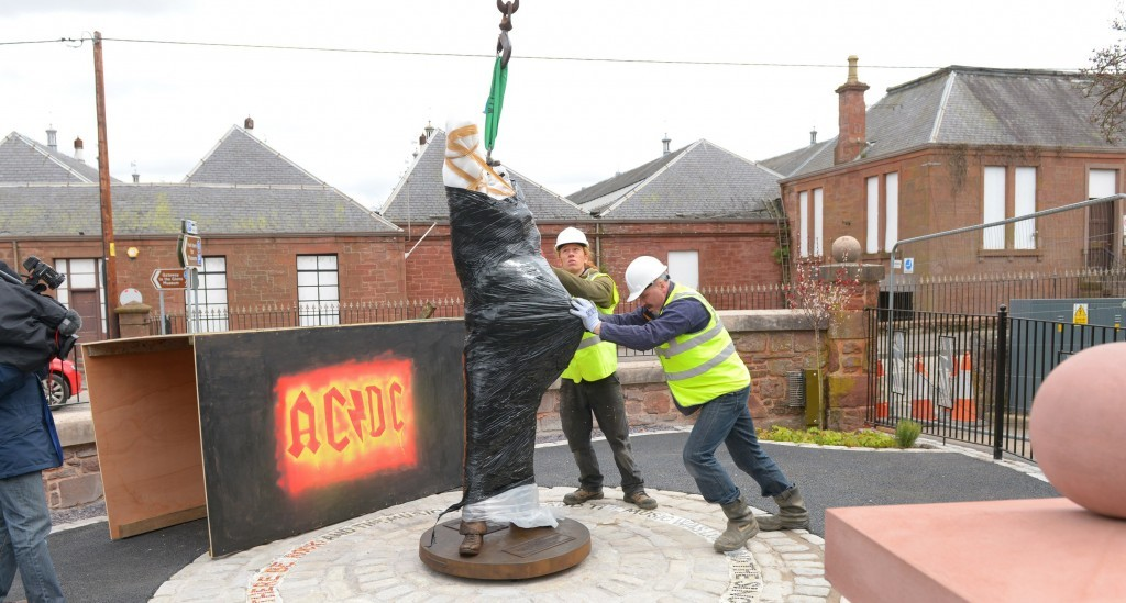 The statue is placed at its new Kirriemuir home.