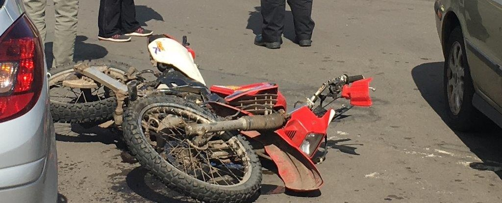 The damaged bike lies on the street after the collision
