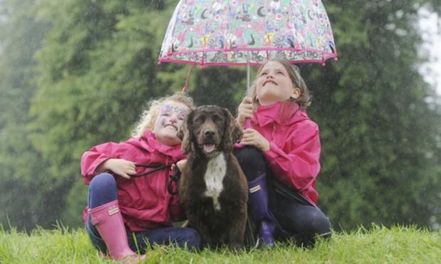 Sophie Cassels, 4, and Imogen Cassels, 6, from Edinburgh with trainee gundog Cooper.