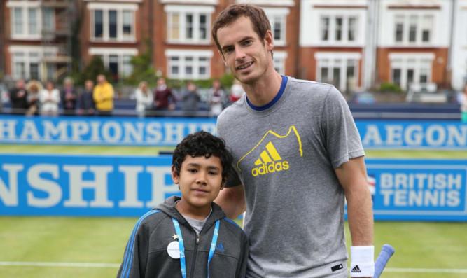 Andy Murray with Elijah Ortiz-Herrera at Queens Club.