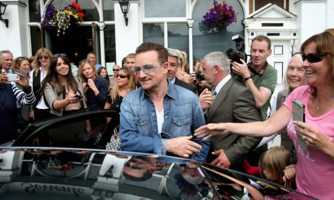 Bono leaves Finnegans in Dalkey after having lunch with the Obamas.