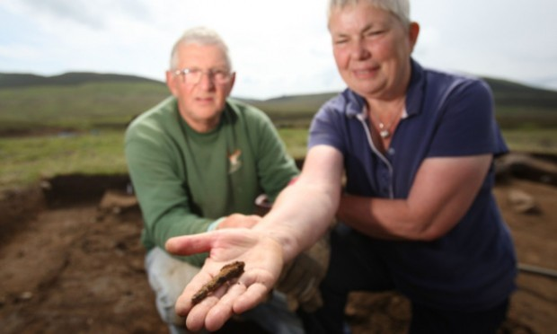 Deryck and Anthea Deane with a possible Pictish iron found at the site.