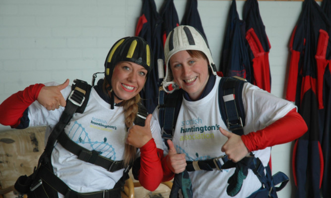 Gemma Barclay and Judith Barber after their parachute jump to raise awareness of the Scottish Huntingtons Association.