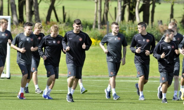 Trialist Nadir Ciftci (centre) training with the rest of the Dundee United squad.