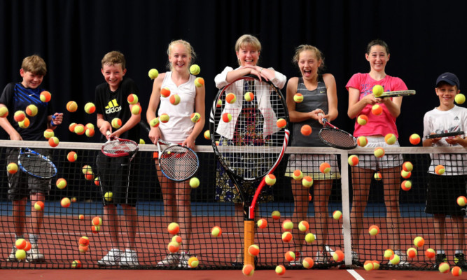 Shona Robison with young players at the Gannochy National Tennis Centre.