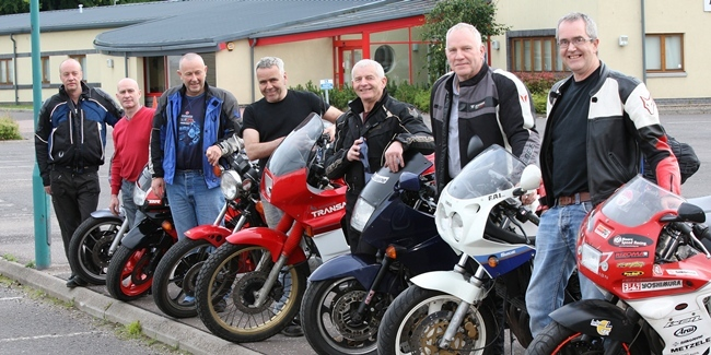 Kris Miller, Courier, 20/06/11. Picture today at Academy Street, Forfar shows the group of 7 friends who are travelling to Greece on £300 motorcycles. Pic shows L/R, Fred Heenan, Gordon Alexander, Jim Morrison, Colin Ritchie, Gordon Phillip, Graeme Phillip and Kim Cessford