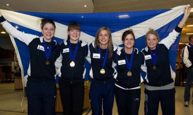 Eve Muirhead (centre) and her team returning to Scotland as world champions in March.