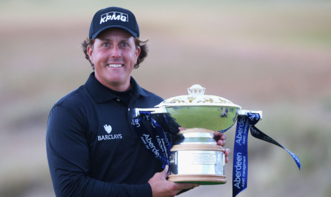 Phil Mickelson with the winner's trophy.
