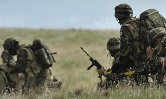 A library photo of soldiers training in the Brecon Beacons.