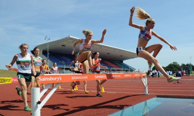 Eilish McColgan leads the way in the 3,000m steeplechase on day three in Birmingham.
