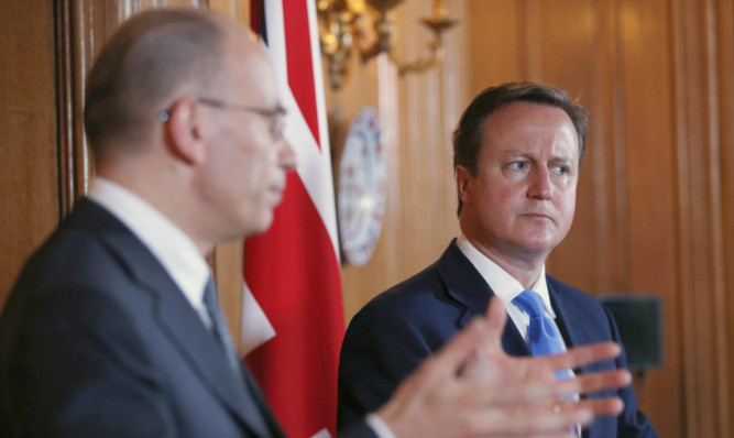 Italian Prime Minister Enrico Letta and David Cameron hold a joint news conference at 10 Downing Street.