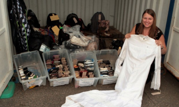 PC Fiona McDougall with some of the unclaimed items from T in the Park  including a wedding dress.