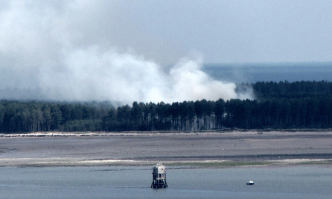 The fire is visible from miles around.