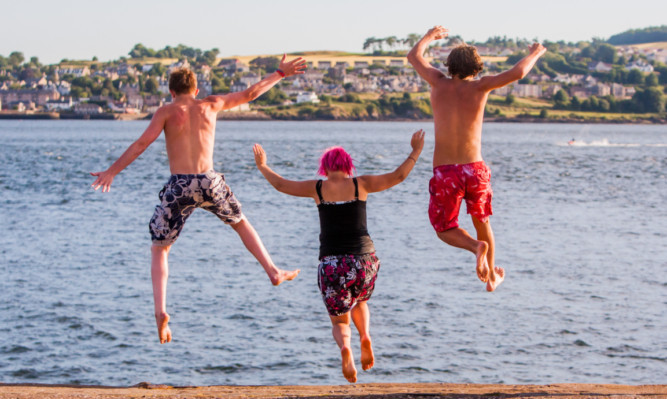 Youngsters jump into the water at Broughty Ferry to cool off during Thursday's scorcher.