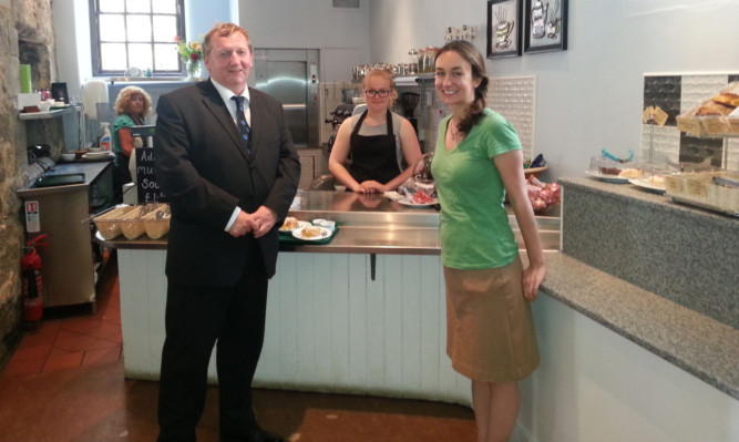Alex Rowley ordering cake and tea at Abbot House, with, from left, Margaret Shiels, Ruyana Ruzgar and heritage director Dr Devon McHugh.