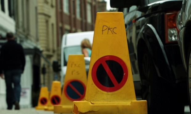Traffic cones set out on George Street, Perth, provoked an angry response from shopkeepers.