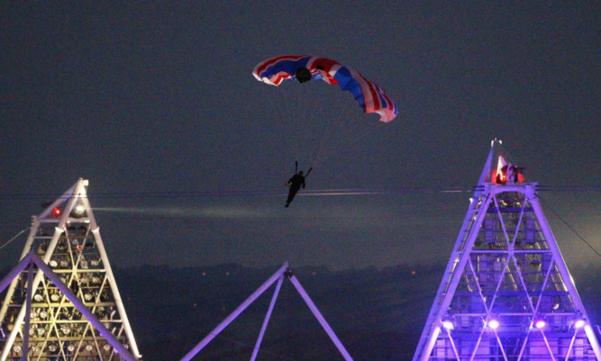 Mark Sutton parachutes into the Olympic Stadium