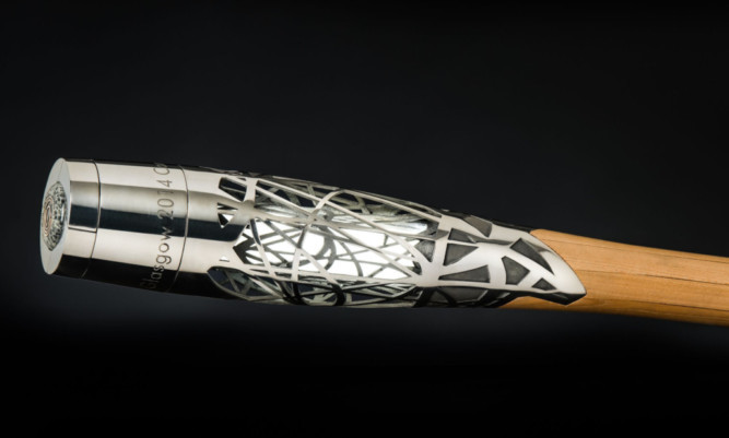 The baton is made of titanium, wood and graphite.