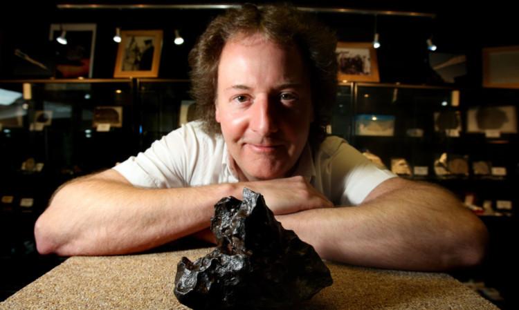 Robert with an iron meteor found in Canyon Diablo in Arizona.
