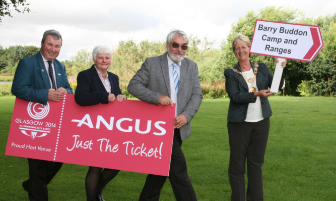 Angus councillors Craig Fotheringham, Jeanette Gaul, Iain Gaul and Provost Helen Oswald are encouraging everyone to snap up their tickets for next years Commonwealth Games, which includes shooting at Barry Buddon.