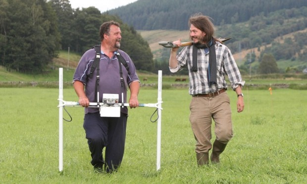 Steve MacDougall, Courier, Grounds owned by the Church, Fortingall. An archaeological dig to discover evidence of early Christian site. Pictured, left is Tony Simpson with a Gradiometer and right is Dr Oliver GT O'Grady, chatting before the work began.