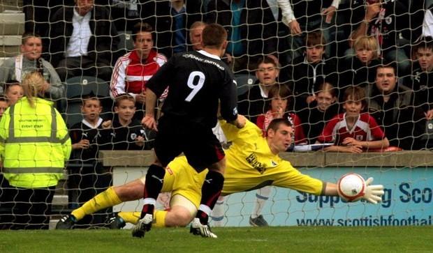 John Stevenson, Courier,21/08/10.Fife.Kirkcaldy,Starks Park,Raith Rovers v Dunfermline Athletic.Pic shows match action,Dunfermlines keeper Chris Smith saves the penalty from Raiths John Baird.