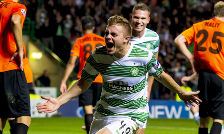 James Forrest celebrates after scoring his side's third goal of the game.