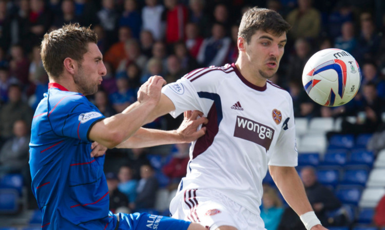 Inverness defender Graeme Shinnie battles for the ball with Callum Paterson.