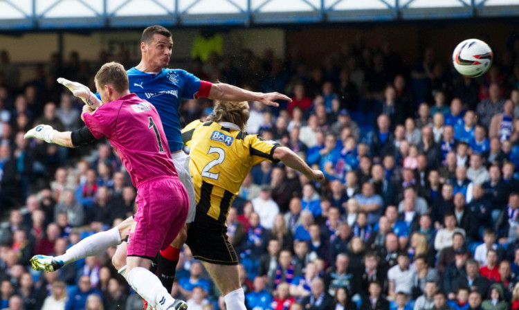 Lee McCulloch gets up highest to head in the second goal of his hat-trick.