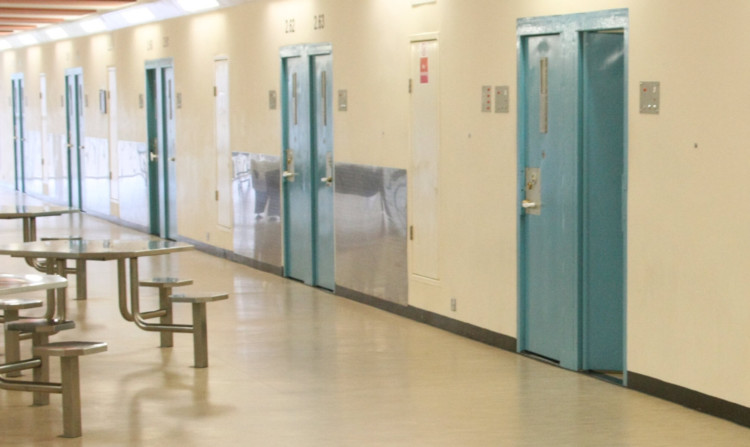 The Scottish Government says the automatic early release for some prisoners will help protect the public.