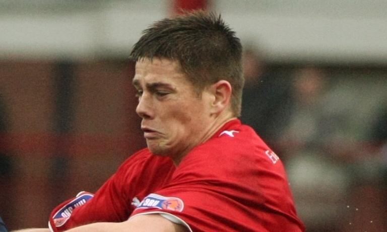 Football, Dundee v Raith Rovers.      Dundee's Leigh Griffiths bursts away from Dougie Hill.