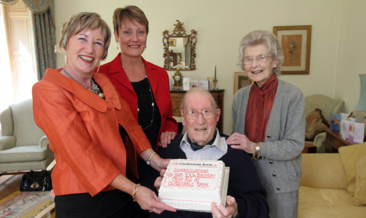 Clydesdale Bank banking partner Jackie Campbell and private associate Sharon Farquharson congratulating Mr Reekie and his wife Elizabeth on his 100th birthday.
