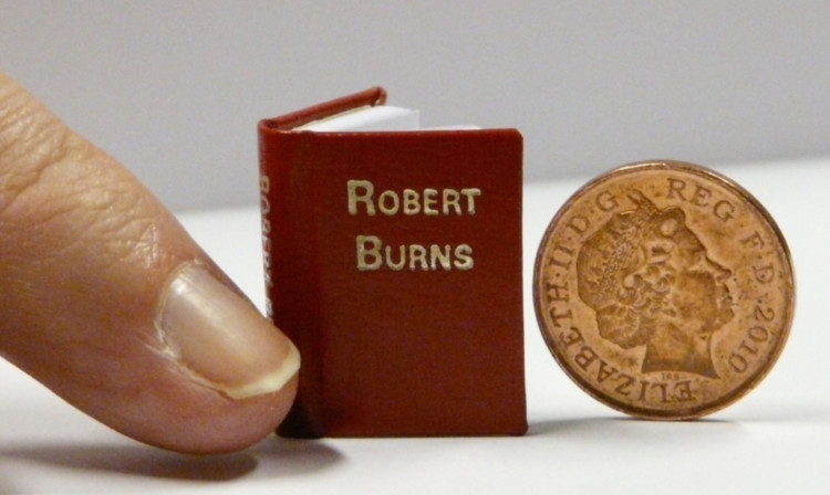 A miniature book of Robert Burns poems will be on display at the National Library of Scotland.