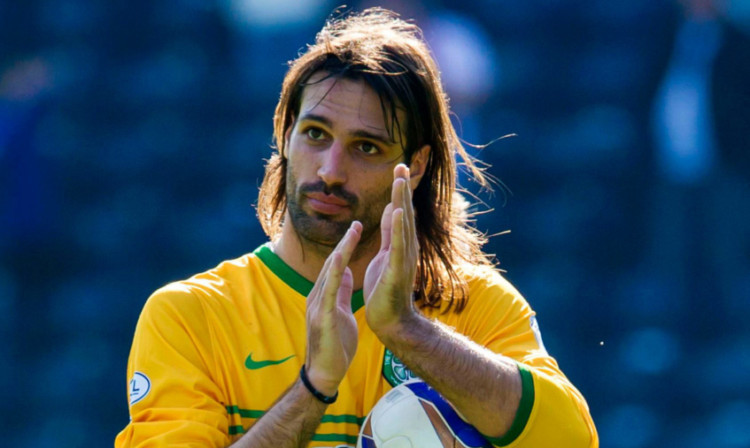 Georgios Samaras claims with the match ball.