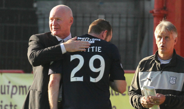 Craig Beattie is congratulated by his manager.
