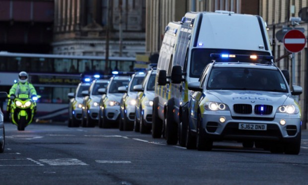 The five people charged with terrorism offences are transported to Glasgow Sheriff Court.