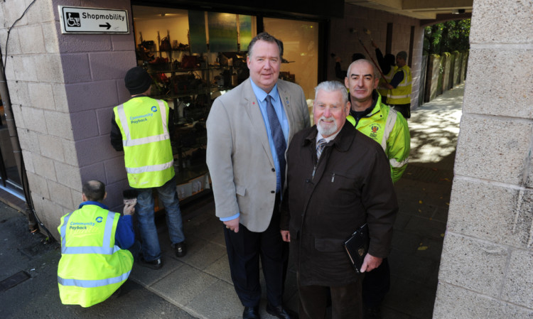 In Ropemakers Close, off South Street, Perth, with some of the people who are serving a community payback order, are, from left, Councillor Douglas Pover, Councillor Jack Coburn and Scott Bryson, community payback supervisor.