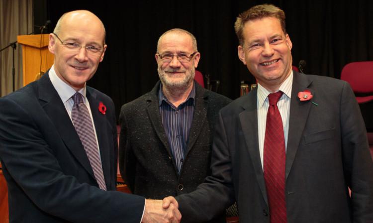 John Swinney (left) and Murdo Fraser (right) with debate chairman Peter Southcott.