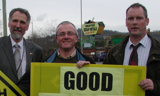 Councillor Lewis Simpson, Councillor Peter Barrett and campaigner Victor Clements celebrate news of the plan's defeat.