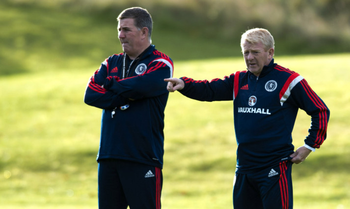 Mark McGhee and Gordon Strachan watching the Scotland squad in training.
