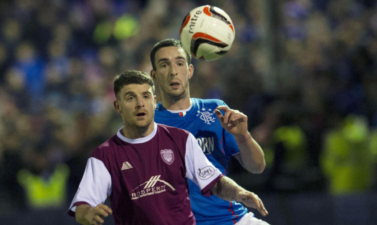 Lichties player Bobby Linn tussles for the ball with Rangers Lee Wallace.