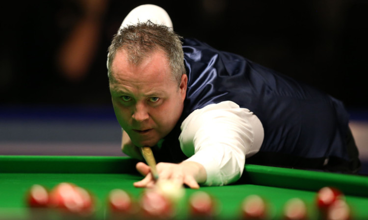 John Higgins hit out at former world champion Joe Johnson after his 6-4 win over Jamie Burnett.