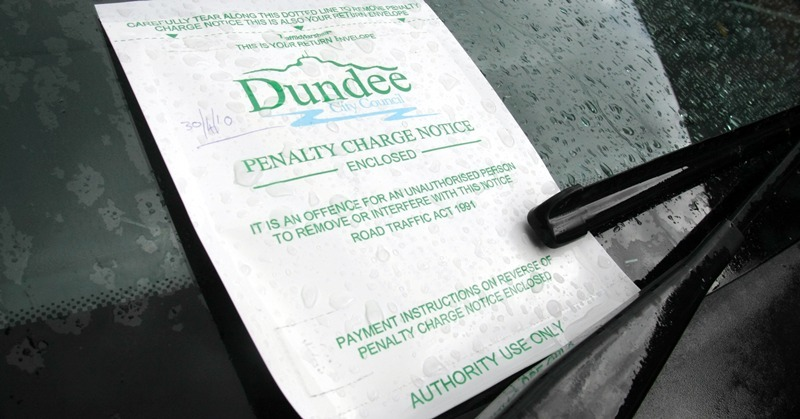 A parking ticket on a car in Dundee.    Parking fine, Penalty Charge Notice.