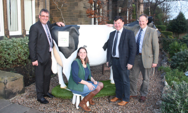 George Lawrie, Sheila Bannerman, Allan Bowie and Rob Livesey with the milkable fibreglass cow
